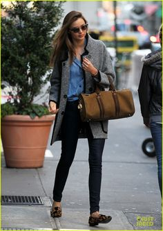 Miranda Kerr walking the streets of New York in a denim on denim ensemble, grey Isabel Marant Khan Suede-Trimmed Boucle Wool-Blend Coat cheetah print loafers and a small Burberry Suede NuBack Leather Bowling Bag.
