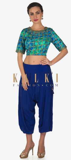Royal blue dhoti pants featuring in crepe. Matched with shaded blouse in silk . Neckline and sleeve are embellished in kundan embroidery. Royal Blue, Neckline, Crop Tops, Embroidery, Free Shipping, Silk, Blouse, Sleeves, Pants