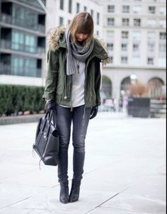 White tee, army coat, jeans, black ankle boots