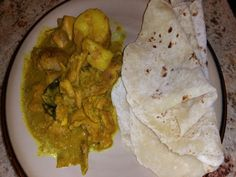 This is a recipe from my Fijian mother; nobody makes it like her!  Since she never uses exact measurements, Ive tried to classify them as best as I can.  (The roti is a flat unleavened bread that is used to eat the curry).  This is definitely spicy and can be quite time consuming to make.  However, after growing up with this dish through the years, its worth it.  Plus, you can freeze the roti in foil and the curry in individual plastic bags for quick and easy meals during the week!