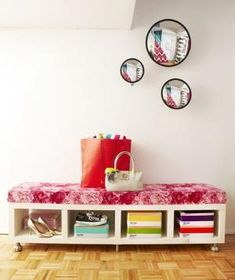 Flipping an Ikea bookshelf on its side, adding wheels and a foam seat with a diy cover and Viola... you have yourself a bench! by Aniky