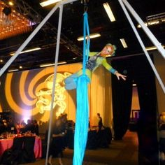 Our cirque-themed aerial artist with her gorgeous turquoise silk and portable rig! Aerialist provided by J and D Entertainment company from Houston, Texas www.jdentertain.com