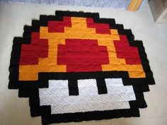 This Batman rug was made up of approximately 360 solid granny squares as a birthday gift for a friend. I used a slightly different method for joining the squares on this project (close up photo to ...