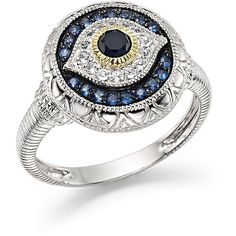 An antiquated talisman of protection is cast in shining white, black and blue sapphires by Judith Ripka.
