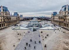 Over view of the pyramids at the Louvre by Yann Caradec