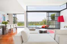 The homeowners were initially drawn to this property because of the stunning, soothing and restful view it offers. Thus, designer Bronwyn Poole strove to make that view a focal point of the home's design. With a minimalist design approach and a carefully selected amount of color to add comfort and joy, Poole was able to bring the view inside the home.