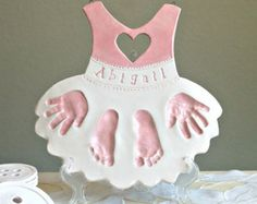 Adorable handprint keepsake for parents and baby. A personalized plaque spelling LOVE with your own childs hand and footprints, name and date. A lovely personalized art wall hanging that can be displayed anywhere in home.What personalizes your home more than a memorabilia designed to honor someone special, your child. Mothers Day orders need to be purchased by March 10 and Fathers day orders by April 10th. Choose your color. As a mother, I adore my cherished keepsakes of my children. I love…