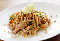 Asian Peanut Noodles with Chicken, Lightened Up is made with stir fried chicken, rice noodles, scallions, carrots, broccoli slaw in a spicy peanut sauce.