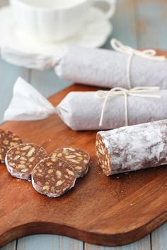 Chocolate salami is just what it sounds like - a chocolate dessert that looks like salami. It's so easy to make and there's no baking required. What you get is a marriage between a cookies and chocolate - crunchy, sweet, and chocolaty. Chocolate Salami Recipe, Chocolate Desserts, Chocolate Tarts, Russian Dishes, Russian Recipes, Russian Desserts, Ukrainian Recipes, No Bake Desserts, Easy Desserts