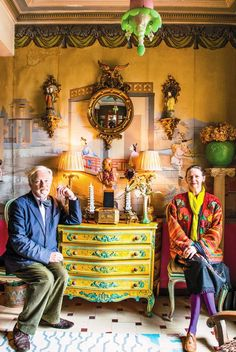 "Lawrence and Anthea Mynott | Artist and graphic designer in their ""little chinoiserie salon,"" with an opaline glass lotus lamp on the ceiling, circa 1840; wallpaper from Madeleine Castaing, circa 1835; a Regency-style convex mirror; Rococo-style gilded plastic sconces; locally made wooden chest of drawers; and Tibetan rug. Photo: Will Sanders - See more at: http://moroccoonthemove.com/2014/04/12/aesthetes-expats-tangier-new-york-times-magazine/#sthash.GerchQpV.dpuf"