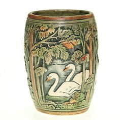 Vintage pottery vase with a repeating scene showing swans swimming on a lake viewed through trees by Weller Knifewood, USA 19th-20th Cent.