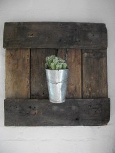 I loved making this! Found this discarded (i think it was a small door) and hooked my catcus onto it. Hung on wall. Perfect!