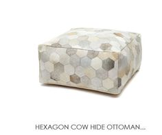 These statement ottomans in stunning complimentary tones Silver/Ivory Hexagon Cow Hide Ottoman at the General Store Furniture Co