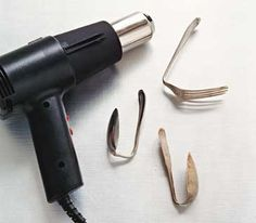 Use a heat gun to make the silver more malleable