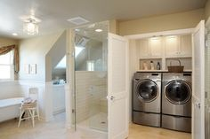 Love the custom finished laundry Closet with custom shelving/cabinets behind louvered doors--Houzz - Home Design, Decorating and Remodeling Ideas and Inspiration, Kitchen and Bathroom Design