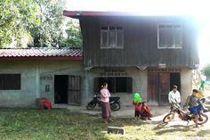 Our home! That's our mom squatting. Ban Na, Laos http://twistedfootsteps.com/vientiane-ban-na-homestaying-hiking-puking/