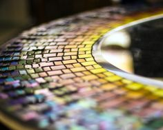 The #Infinite #Rainbow #Mirror is created with hand cut #mosaic #glasstiles of varying textures, some having #iridescent quality that give the #mirror piece a #mystic look as it gleams with different hues at different angles. The #square shaped #glass beads add a 3 dimensional effect to the creation that fill up spaces between the rainbow rays.