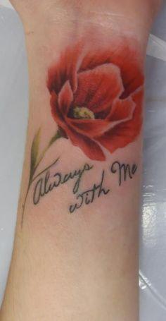 Beautiful poppy tattoo by Jenny at Sandra's Ink.