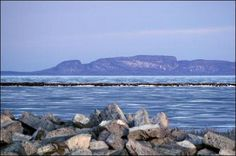 The Sleeping Giant is a sill and mesa formation on Lake Superior along the Sibley peninsula, and when viewed from the City of Thunder Bay, resembles a sleeping giant. It's cliff are amongst the highest in Ontario and provide superb multi pitch rock climbing. Ojibway legend identifies the giant as Nanabijou which turned to stone when the location of the rich silver and copper mine now known as Silver Islet was disclosed to the white men. Places To See, Places Ive Been, Ontario Travel, Turn To Stone, O Canada, Lake Superior, Great Lakes, Beautiful Landscapes, Beautiful Places