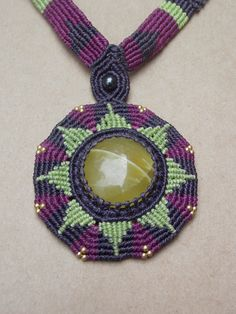 Sunburst Macrame Necklace/Onyx/Green Stone/Neon Green/Goddess Necklace/Sun Jewelry/Purple/Healing Stone. $62.00, via Etsy.