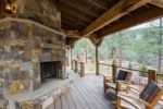 Rustic Riverside Cabin Rear Deck and Fireplace