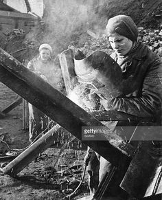 Women welding 'hedgehogs' (anti-tank barricades) as part of the civilian war effort for the defense of moscow during world war 2. Show more