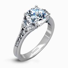 This classically designed white gold ring is emphasized by .18 ctw of white diamonds and .51 half moon shaped diamonds to create a memorable setting.