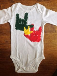 American Sign Language I love you onesie in Rastafarian colors.