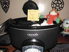 Silly elf thinks the crock pot is a hot tub!