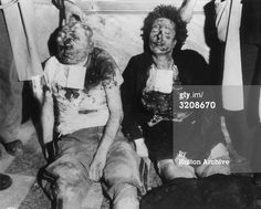 28th April 1945: View of the mutilated bodies of Benito Mussolini (1883 - 1945) and his mistress, Clara Petacci, propped up against a marble wall in Milan, Italy, World War II. The couple had tried to escape to Switzerland but were caught and executed by Italian partisans. (Photo by Hulton Archive/Getty Images)