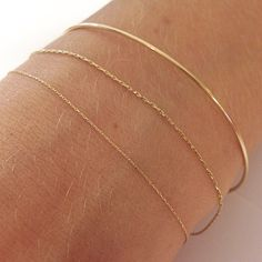 Pønt 18K Gold arm ring and silk cord bracelets