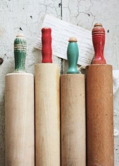vintage rolling pins - love the handle colors. (already on the porch!)