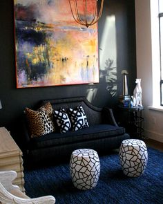 black walls and colorful living room