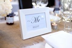 hessian table runners, tealights and jars of white flowers for this rustic elegant wedding