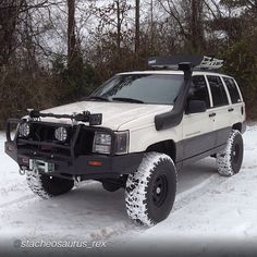 Jeep cherokee in the snow with snorkel