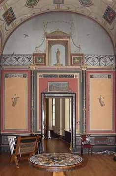 a photo of a room with ornate decoration and fresco painting