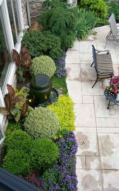 Sculpted miniature shrubbery & perennials created for pops of contrasting colors. Beautiful from every view!