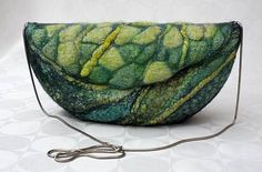 This hand felted eco friendly womans purse made from the Merino wool, silk and various plant fibers using wet felting technique. Soft and comfortable, good gift for friends and loved ones any time of year. Light, fuzzy and warm, perfect for coming winter. Will make a great present! Ready to