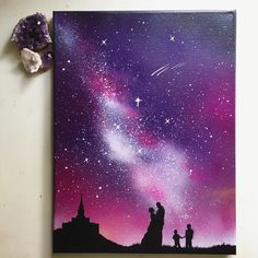 Space painting for families.