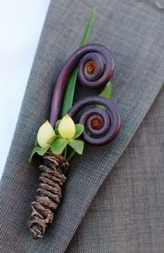 Love the fiddlehead in the boutonniere....almost looks like a butterfly.