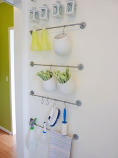 Use the wall for extra storage. This system of rods and hooks from Ikea is a great place to stash dryer sheets, a lint brush and stain remov...