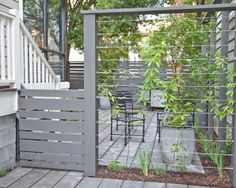 How To Complete Your Exterior Designs with Cool Fence Mounted Mailbox Ideas: Charming Fence Mounted Mailbox Cable Fence White Railing Stairs Outdoor Chairs Wooden Floor Planter Pot ~ curveriderhq.com Exterior Designs Inspiration