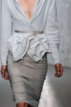 Dress for Success Donna Karan---grey vneck tailored jacket w/raggedy but structured peplum hem, grey ruched pencil skirt.
