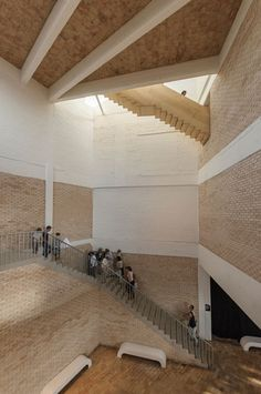 A five-sided pavilion made from pale sandy brickwork leads inside this former textile factory