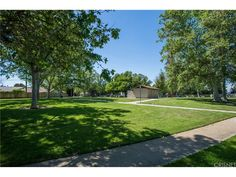 Sun Room leads to a Large Backyard perfect for family BBQ's with Fruit Tree and Roses. Street ends in a Cul-de-sac, Nearby are Parks, Golf Course, Dog Park, Bike and Walking Paths, Picnic Areas, Lake Balboa, Restaurants and Shopping. Conveniently located for your commute to work using the Orange Line or Freeways.
