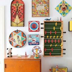 Great idea for kids/game room. Vintage board games as decor.