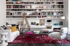 parisian chic interiors | Sweet Parisian Apartment With A Bright Carpet in Living Room