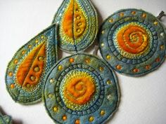 embroidered ornaments by dog daisy chains
