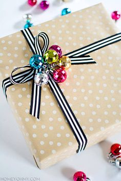 "Tired of trying (and failing) to wrap bows — or not being able to keep them stuck on the package? This mini disco ball package topper gives ""seasonal festivities"" a whole new meaning, and adds a whole lot of glam to your holiday gifts. Find the full tutorial at Homey Oh My.   - HouseBeautiful.com"