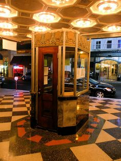 booth from behind art deco box office loew